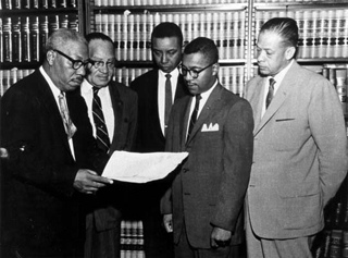 Attorney Conrad Odell Pearson (left) with attorneys, Hugh Thompson, Floyd McKissick, William G. Marsh, and John H. Wheeler.   Photo courtesy of The Herald Sun. Originally from North Carolina Collection, Durham County Library.