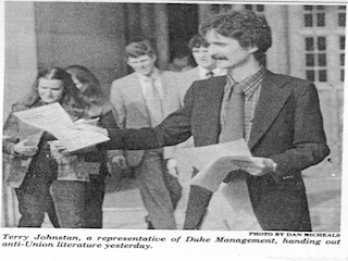 """Terry Johnston, a representative of Duke Management, handing out anti-Union literature"" on Thursday, February 15th, 1979, the day before 2100 Duke Hospital employees were to vote on whether or not to unionize. (courtesy of The University Archive and ""The Duke Chronicle"", photo by Dan Michaels)"