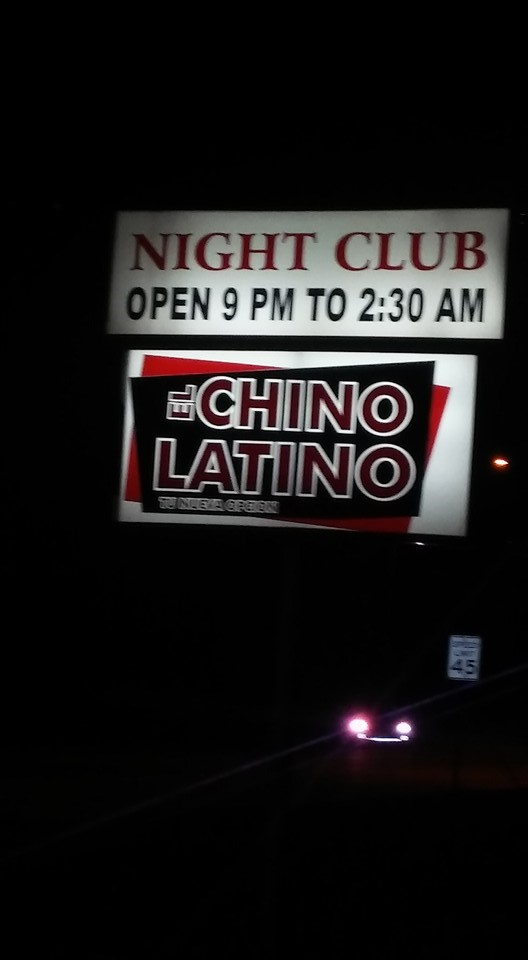 Roadside signage lights the way to El Chino Latino