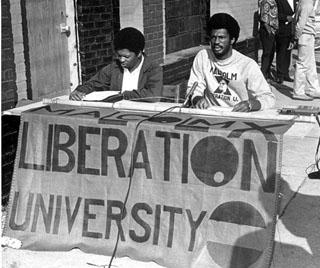Howard Fuller worked throughout North Carolina on poverty issues and was the leader of the group that founded MXLU. He is pictured (right) registering students for classes in 1969. Photo courtesy of Durham Herald Sun