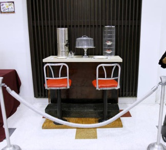 A portion of the original lunch counter, its seats, and pie rack preserved in the James E. Shepard Memorial Library at North Carolina Central University.  Photo by Takaaki Iwabu.