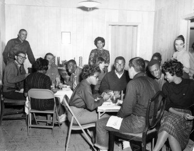 Christmas at the McKissick home on Roxboro Street, with CORE staff and volunteers in 1964.